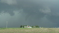 Tornado over farm buildings in Iowa Stock Footage