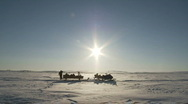 Stock Video Footage of Arctic desolation, snowmobile on ice field