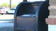 Post office box mail drop off medium shot - HD  Stock Footage
