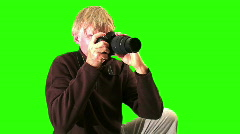 Photographer against green medium shot - HD  Stock Footage