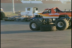 Motorsports, monster trucks crushing cars and running over tires Stock Footage