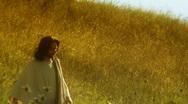 Stock Video Footage of Jesus walks in field