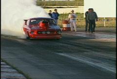 Motorsports, NHRA drag racing, pro mod burnout Stock Footage