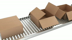 Cardboard boxes closing on conveyor belt Stock Footage