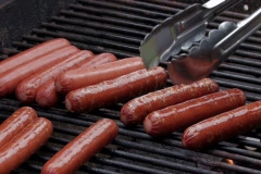 Grilling hot dogs on a barbecue Stock Footage