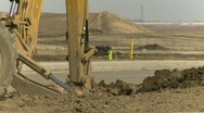 Construction, backhoe tractor on construction site, #6 very long shot Stock Footage
