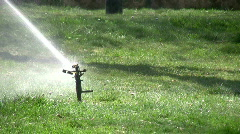 Grass sprinkler slow motion Stock Footage
