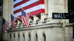 Stock Video Footage of Wall Street with American Flags