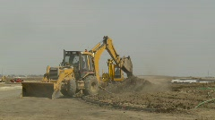 construction, backhoe tractor on construction site, digging, medium long - stock footage