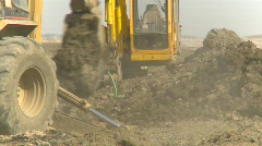 construction, backhoe tractor on construction site, #8 with second tractor in bg - stock footage
