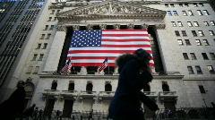 NYSE & silhouetted pedestrians Stock Footage