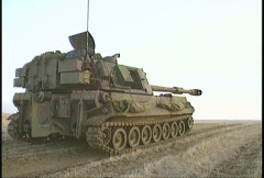 Military, M109 self propelled howitzer, 3/4 angle of round fired Stock Footage