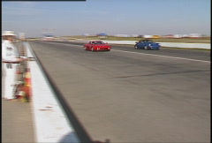 Motorsports, roadcourse racing exotic cars, Porsche and Ferrari Stock Footage