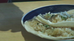 Splating hot sauce on rice tacos Stock Footage