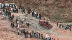 Truck crawling up Moab rock hill P HD Stock Footage