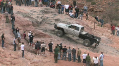 Truck crawling over top up Moab hill P HD Stock Footage