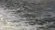 Closeup of river's flowing surface as it ripples (High Definition) Stock Footage