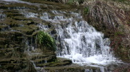 Water flows down the jagged rocks, creating waterfalls (High Definition) Stock Footage
