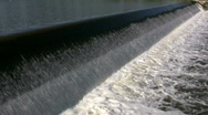 Water flows over a weir, creating small waterfall (High Definition) Stock Footage