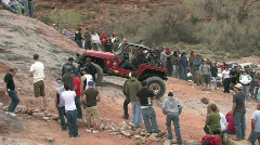 Red 4x4 up rocks Moab UT M HD Stock Footage