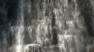 Close-up of water flowing down a rock wall (High Definition) Stock Footage