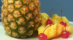 Pinapples and cherries tilt in shot Stock Footage