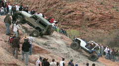 Moab two jeeps crawl up hill M HD Stock Footage