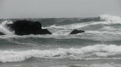 Waves crashing into rocks- gray Stock Footage