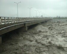 Extreme River Flood Under Road Bridge Stock Footage