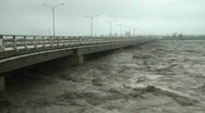 Stock Video Footage of Extreme River Flood Under Road Bridge