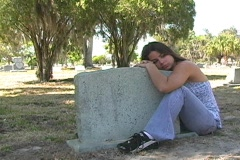 Beautiful Brunette in a Cemetery-11a Stock Footage