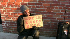 Homeless man with Beer Sign - stock footage