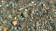 Colourful beach pebbles - stock footage