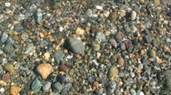 Colourful beach pebbles Stock Footage