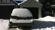Shovelling snow off car.  Stock Footage