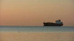 Oil tanker at sunrise with geese Stock Footage