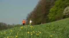 Nordic Walkers walking into focus Stock Footage