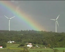 Windturbines  with clouds and rain  with rainbow Stock Footage