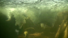 Underwater shot below a small waterfall Stock Footage