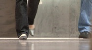 Walking On Shiny Refelctive Floor Stock Footage
