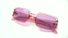 Cleaning Pink Sunglasses Stock Footage