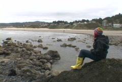Woman on Ocean Rock 7 Walk Away Stock Footage