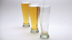 Three glass beer pour - HD  Stock Footage