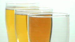 Three glass beer pour close-up - HD  Stock Footage