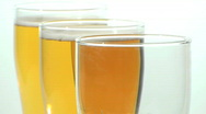 Stock Video Footage of Three glass beer pour close-up - HD