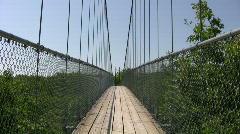 Suspension bridge gently sways in the wind (High Definition) Stock Footage