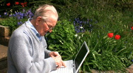 Stock Video Footage of elderly gentleman on a laptop