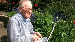 Elderly gentleman on a laptop Stock Footage