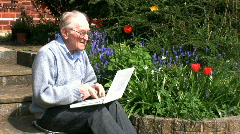 Elderly gentleman on a laptop Stock Footage