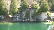 Kids are jumping from cliff into a lake (High Definition) Stock Footage